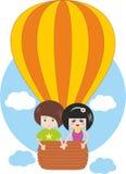 Niños que vuelan en el globo del aire caliente Fotos de archivo