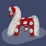 Niños rojos del caballo del juguete Foto de archivo