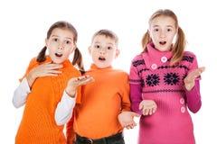 Niños sorprendidos Fotos de archivo