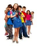 Niños y muchacha con los prismáticos Fotos de archivo