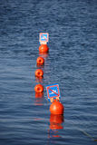 No swimming buoy signs Stock Image