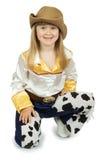 Niña bonita en traje del vaquero en el fondo blanco Fotografía de archivo