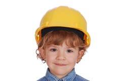 Niña con el retrato amarillo del casco Foto de archivo libre de regalías