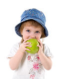Niña con la manzana verde Imagen de archivo