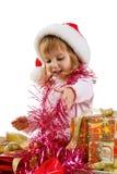 Niña con un regalo de Navidad Imagen de archivo libre de regalías