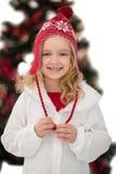 Niña festiva en sombrero y bufanda Fotografía de archivo
