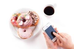 Śniadanie z donuts Obrazy Royalty Free