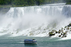 Niagara American Falls and touristic boat Royalty Free Stock Photo