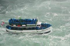 The Niagara fall and boat Stock Photography