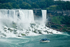Niagara Falls. American side of the Niagara falls. Tourist boat in the foreground royalty free stock photo