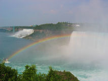 Niagara Falls. With a rainbow and tourist boat royalty free stock images