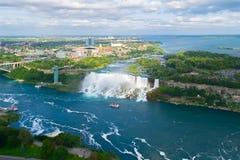 Niagara Falls. American falls. Boat with tourists moves along Bride Veil Falls. Canada, USA. American Niagara Falls. Panoramic view from Canadian side, Ontario stock image