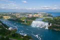 Niagara Falls. American falls. Ontario, Canada. New York, USA. Niagara Falls. American falls. Boat with tourists moves along Bride Veil Falls royalty free stock image