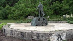 Niagara Falls, Canada - June 24, 2018: The statue of Nikola Tesla in Niagara Falls. Niagara Falls, Canada - June 24, 2018: The statue of Nikola Tesla, a Serbian stock footage