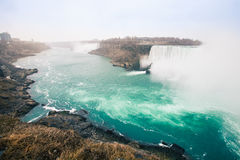 Niagara Falls. Is the collective name for three waterfalls that straddle the international border between Canada and the United States; more specifically royalty free stock photography