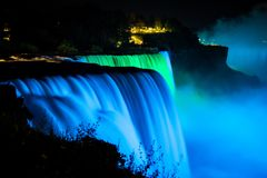 NIagara falls illuminated with color lights at night stock photo