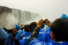 NIAGARA FALLS. JUNE 7: Tourists in the Maid of the Mist on June 7 , 2011 in , Canada. The Maid of the Mist is a boat tour where tourists can experience the Stock Photography