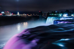 Niagara Falls light show. Viewed from the US side, one feet away from Bride Veil Falls. The long exposure creates a silky water effect royalty free stock photo