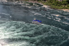 Niagara Falls and the Maid of the Mist. The Maid of the Mist carries passengers to the base of the Horseshoe Falls, part of the Niagara Falls in Ontario, Canada Stock Photo