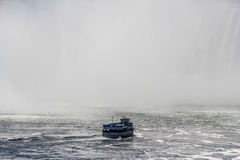 Niagara Falls Maid of the Mist. Shot of a tourist vessel dwarfed by the gigantic Niagara Falls Stock Images