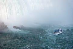 Niagara Falls and Maid of the Mist Tour Boat. This is a view of a tour boat, Maid of the Mist, navigating near the horseshoe falls in Niagara Falls, Ontario Stock Photography