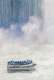 Niagara Falls and Maid of the Mist Tour Boat. Niagara-Falls, Ontario, Canada - July 5, 2015: View of a tour boat, Maid of the Mist, navigating near the horseshoe Stock Photo
