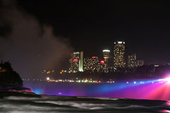 Niagara Falls by Night. With Canadian part of the city in a background Stock Images