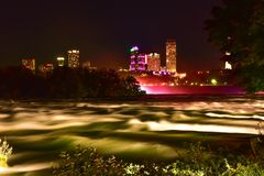 Niagara Falls at night on Autumn season. Niagara Falls on Autumn season. Niagara Falls is a city in Niagara County, New York, United States. It is adjacent to royalty free stock photography