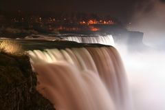 Niagara Falls at night with light up. Here is three waterfalls located at international border between Canada and the United States Stock Photography