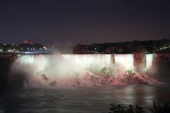 The Niagara Falls at night was illuminated by the lights. Niagara Falls is situated at the junction of Ontario, Canada and New York State of the United States royalty free stock image