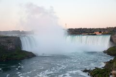 The Niagara Falls at night was illuminated by the lights. Niagara Falls is situated at the junction of Ontario, Canada and New York State of the United States stock photos