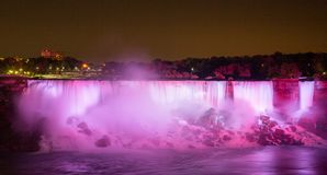 The Niagara Falls at night was illuminated by the lights. Niagara Falls is situated at the junction of Ontario, Canada and New York State of the United States stock image