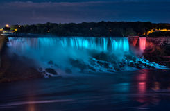 Niagara Falls Nighttime Panorama. A nighttime panoramic view of the American side of the Niagara Falls, illuminated by floodlights from the Canadian border in royalty free stock photography