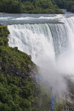 Niagara falls, NY, USA. Its one of the most popular tourist place in NY. Close up picture, many people visible on their way to touch and feel powerful, mighty Royalty Free Stock Photo
