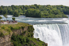 Niagara falls, NY, USA. Its one of the most popular tourist place in NY. Close up picture, many people visible on the view point platform Royalty Free Stock Photo