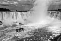 Niagara Falls One Boat Black and White. Rushing Falls royalty free stock photos