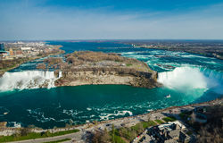 Niagara falls ontario canada horse shoe falls. A view of Niagara falls from Canada shot from the skylon in Ontario day time ultra wide angle with two falls stock photo