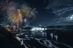 Niagara Falls in Ontario at night with fireworks Stock Photography