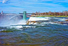 Niagara Falls and the Rainbow Bridge above Niagara River Gorge Royalty Free Stock Photography