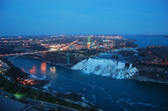 Niagara Falls and rainbow bridge at night Royalty Free Stock Photos