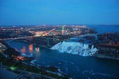 Niagara Falls and rainbow bridge at night royalty free stock photos