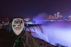 Niagara Falls Tourist Binoculars at night. Tourist binioculars with the Niagara Falls lit up in the background Royalty Free Stock Photo