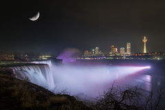Niagara Falls Under The Moon. Long exposure of Niagara Falls from New York side lit up with white light Royalty Free Stock Images