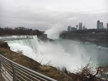 Niagara Falls United States side. Pure power in the water spilling down the falls on a hazy Royalty Free Stock Image