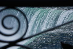 Niagara Falls viewed through Wrought Iron Fence Royalty Free Stock Images