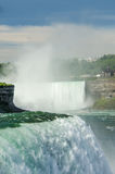 Niagara Horseshoe Falls and Maid of the Mist. The Niagara Horseshoe Falls on the Niagra river with mist rising into a blue sky with clouds and the Maid of the Royalty Free Stock Images