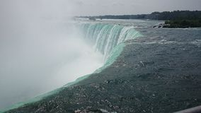 Niagara. Just as the waters tip over the edge of the falls, Canada Stock Image
