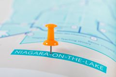 Niagara-on-the-Lake map with push pin pointing at it. Niagara-on-the-Lake is a town in southern Ontario. It sits on the shores of Lake Ontario, at the mouth of royalty free stock photo