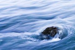 Niagara River Rapids. A rock standing against the turbulent Niagara river rapids Stock Photo