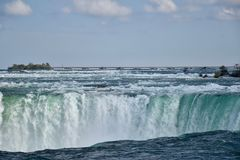 Plunging down 2: the Niagara River becomes Niagara Falls Royalty Free Stock Images